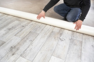 rolling out a PVC flooring